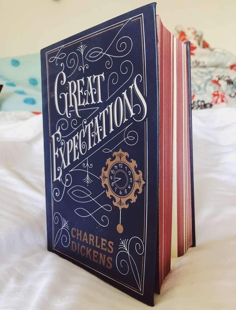 Great Expectations by Charles Dickens sitting open